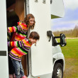 Kids in camper, family vacation — Stock Photo