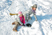 Children playing with snow in winter — Stock Photo