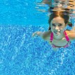 Happy active child swims underwater in pool — Stock Photo #26649711