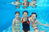 Happy family swim underwater in pool — Stock Photo
