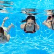 Happy family swim underwater in pool and having fun — Stock Photo #28843913