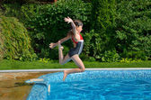 Girl jumps to swimming pool — Fotografia Stock