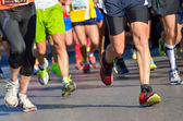 Marathon running race, people feet on road — Stock Photo
