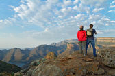 Happy couple looking at beautiful view of Blyde river canyon — Stock Photo