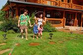 Happy family having fun in the garden — Stock Photo