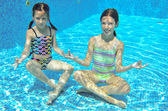 Happy active kids play underwater in swimming pool — Stock Photo