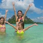 Happy family having fun in sea near tropical island — Stock Photo #50146929