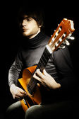 Acoustic guitar guitarist player — Stock Photo
