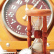 Stock Photo: Hourglass and clock old watches
