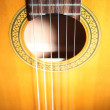 Stock Photo: Acoustic guitar strings details.