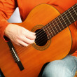 Stock Photo: Acoustic guitar playing close up