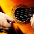 Stock Photo: Acoustic guitar playing details