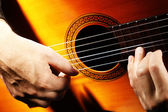 Acoustic guitar playing details — Stockfoto