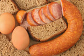 Sausage, bread and eggs — Stock Photo