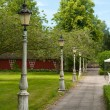 Stock Photo: Line of lampposts in garden