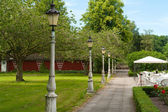 Line of lampposts in a garden — Stock Photo