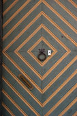 Bright traditional colrful painted wooden door — Stockfoto