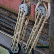 Stock Photo: Nautical ropes and pulley on sail boat