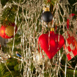 Christmas decoration balls and hearts on a tree — Stock fotografie