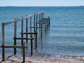 Beautiful seascape of a wooden footbridg — Stock Photo