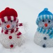 White Christmas - cheerful blue and red snowman — Stock Photo #17148661