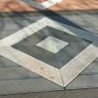 Details of geometric gray stone garden tiles - Photo