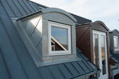Modern vertical roof windows — Stockfoto