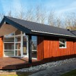 Photo: Modern design attractive small wooden home