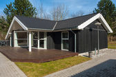 Modern design attractive wooden home — Stock Photo