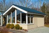 Modern design attractive small wooden home — Stock Photo