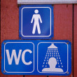 Sign of public toilets WC shower for men - Photo