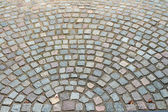 Old cobbled stones road background — Stock Photo
