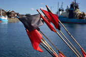 Fisherman flags on fishing boat — Stock Photo