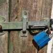 Door with heavy lock padlock — Stock Photo