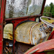 Abandoned rusty old tractor — Stock Photo