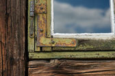 Old grunged wooden window — Stock Photo