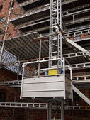 Scaffolds on a house building under renovations — Stock Photo