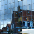 Architecture Old house reflection in New building — Stock Photo #9117064