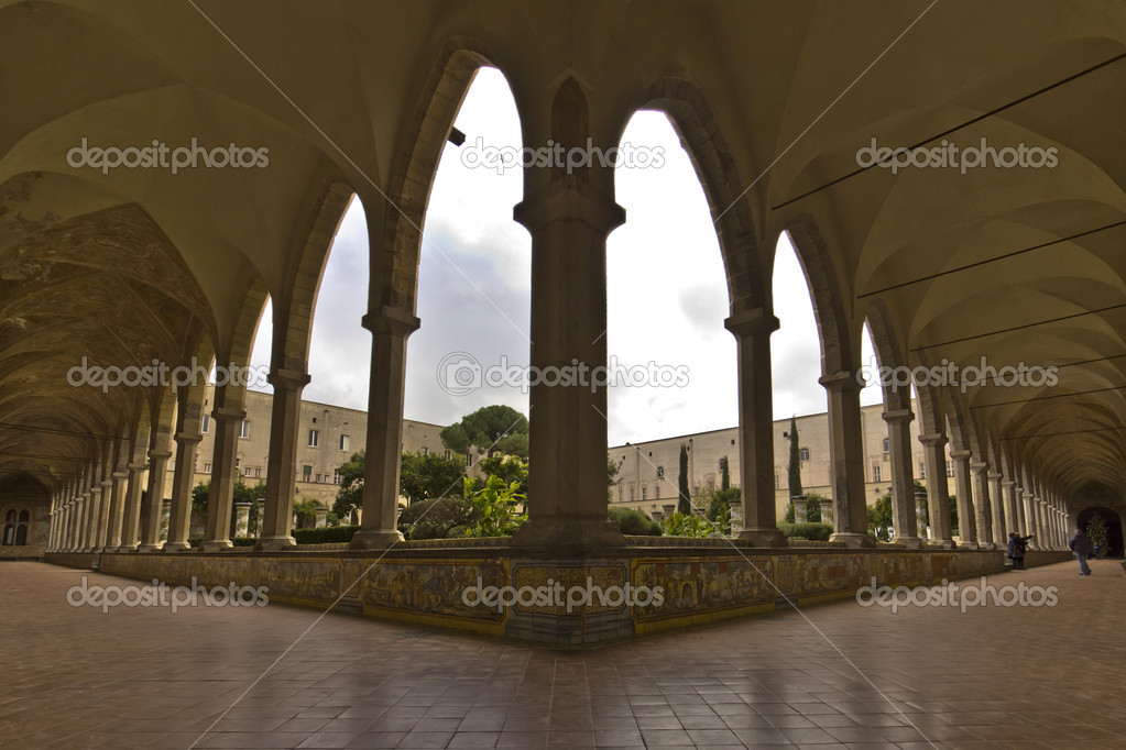 View of the colonnade in the majolica cloister of the monastery of st. chiara — Stock Photo #18640557