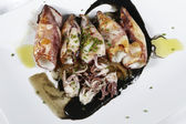 Squid in its ink — Stock Photo
