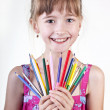 Young girl with pencils — Stock Photo
