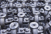 Industrial background from part of valves — Stock Photo