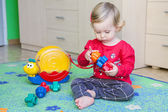 Little baby is playing with toys — Stock Photo