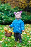 Laughing kid standing in an autumn park — Stock Photo
