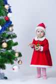 Christmas baby girl in a cap of Santa Claus — Stock Photo