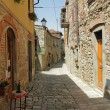 Narrow stony street in tuscan borgo Montefioralle — Stock Photo
