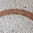 Detail of cobblestone pavement — Stock Photo