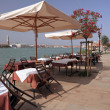 Restaurant  on Giudecca island with amazing view of Venice - Stock Photo