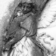 Child in angelic arms — Zdjęcie stockowe #12797309