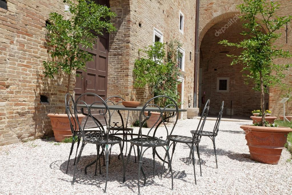 Garden furniture on italian backyard — Stock Photo ...